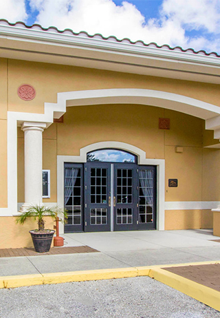 Front exterior building entrance at Robert Toale and Sons Funeral Home at Palms Memorial Park