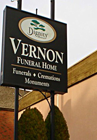 Front exterior building and signage at Vernon Funeral Home