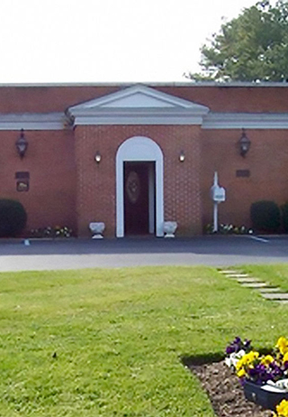 Front exterior building with signage at Smith & Williams Funeral Home/Kempsville