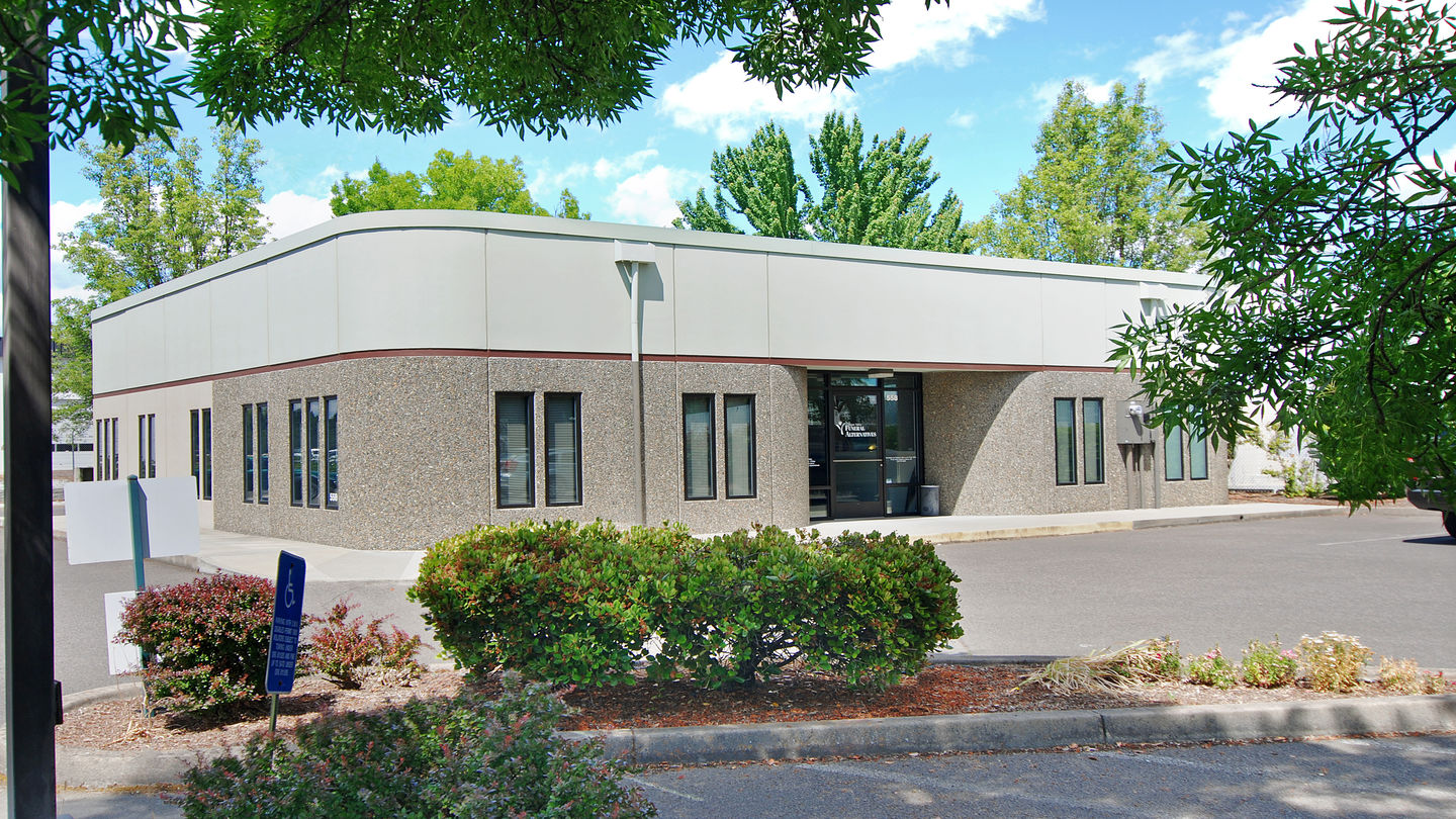 Front exterior building entrance with parking lot at Rogue Valley Funeral Alternatives