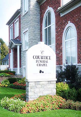 Front exterior building and signage at Courtice Funeral Chapel