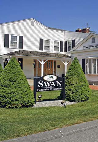 Front exterior building entrance and sign at Swan Funeral Home.