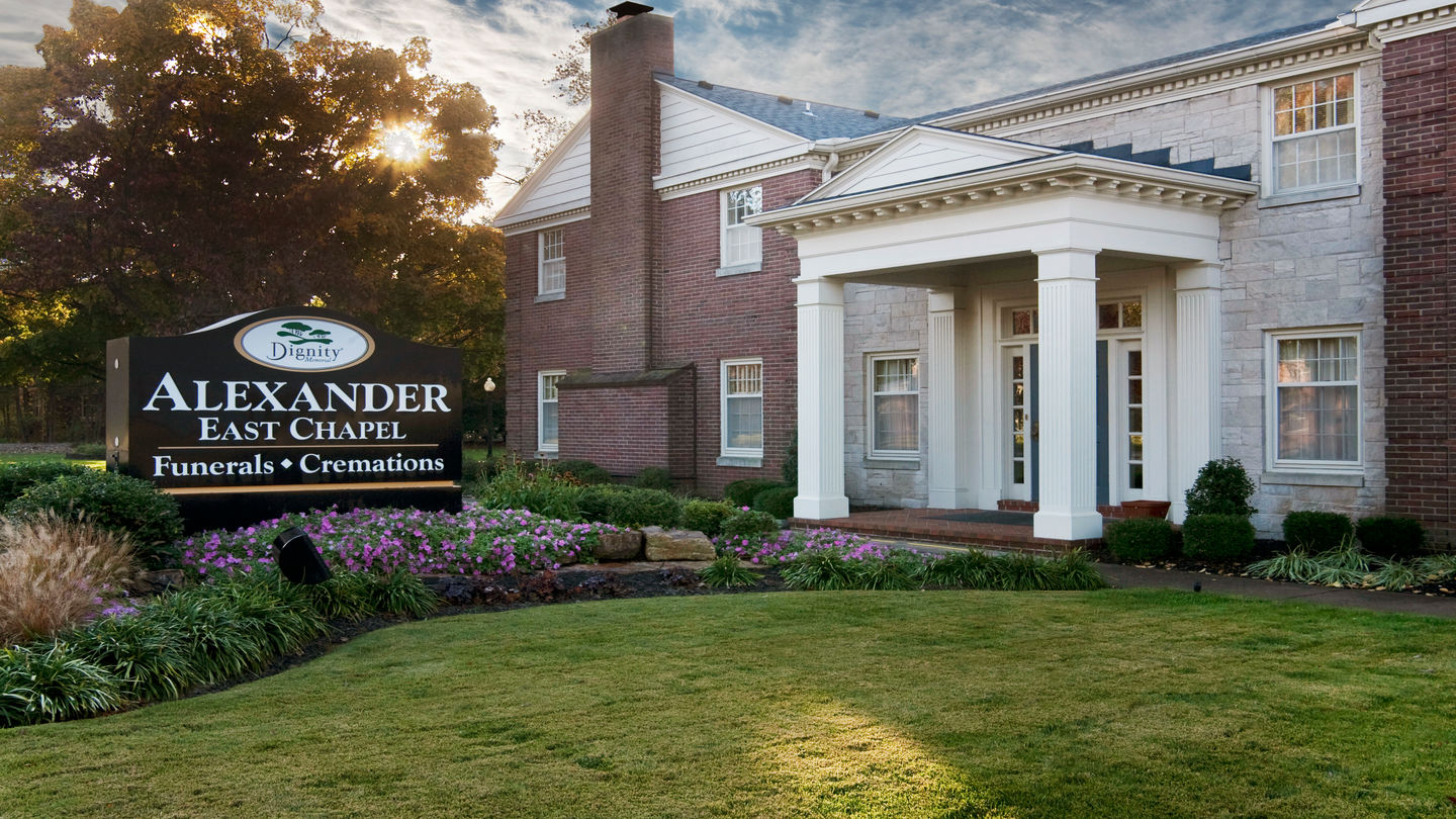 Front exterior building with sign and entrance at Alexander Funeral Home-East Chapel.