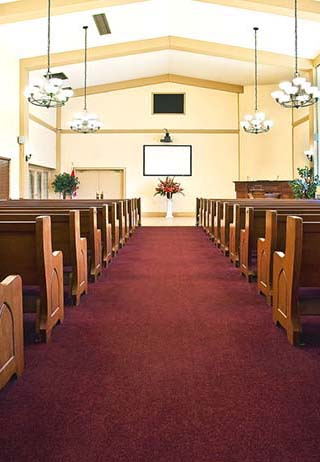 Chapel with down the aisle view at Mount Pleasant Universal Funeral Home.