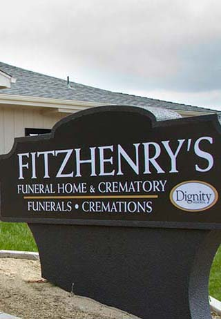 Front exterior entrance wit sign at FitzHenry's Funeral Home.