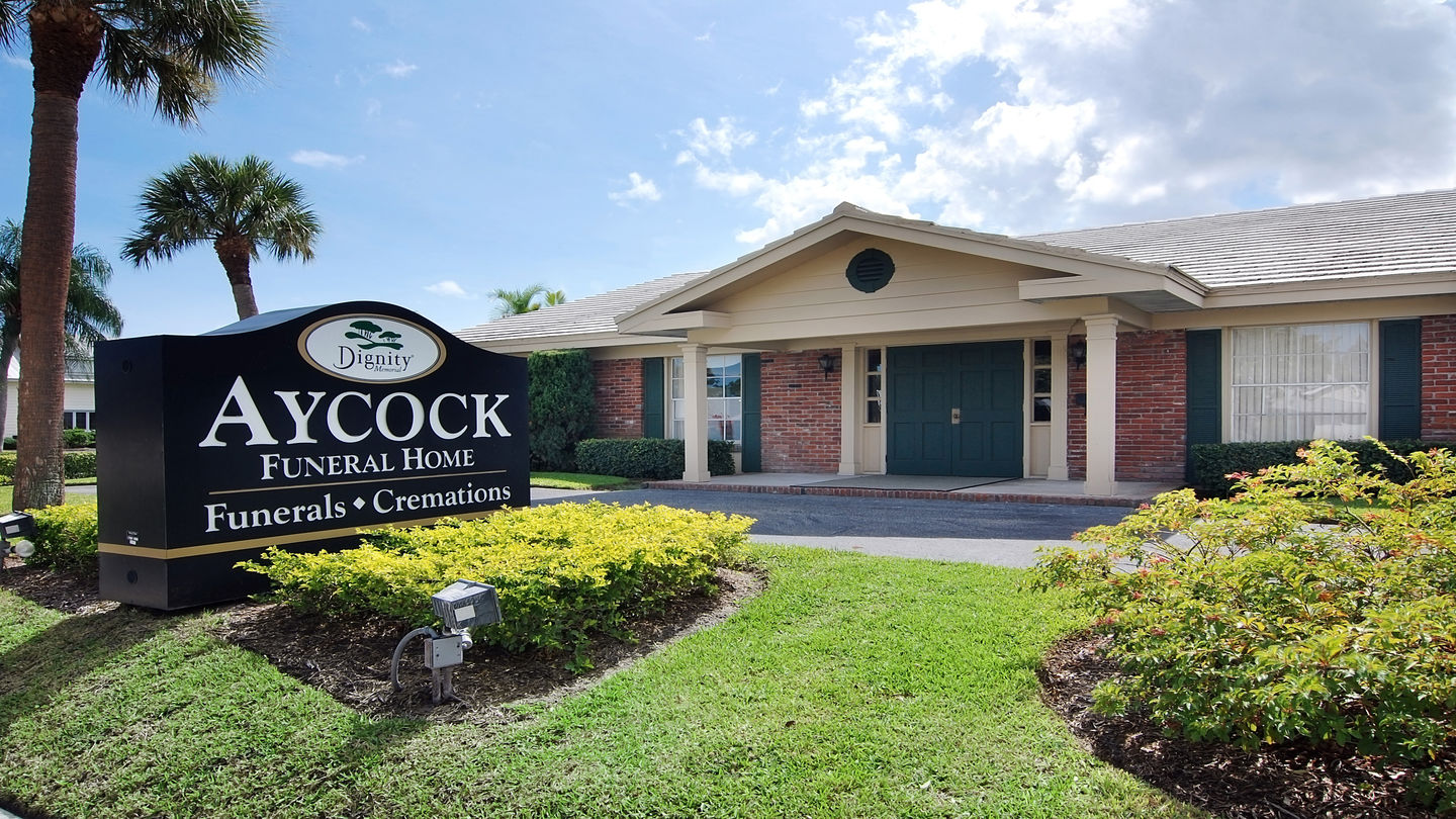 Front exterior building with signage at Aycock Funeral Home