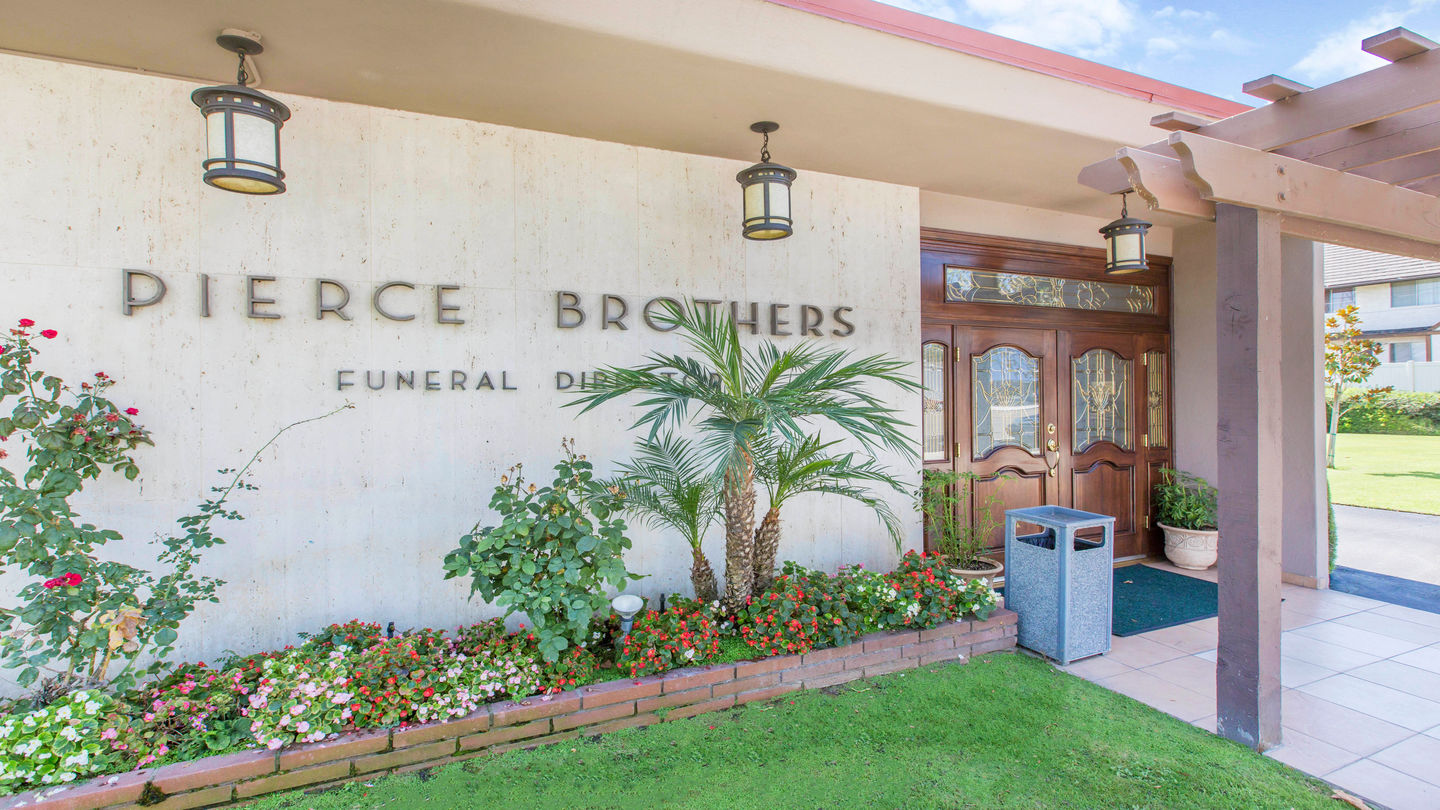 Front exterior building with signage at Pierce Brothers Turner & Stevens Mortuary