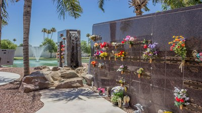 Columbariums by pond at Sunland Memorial Park & Mortuary.