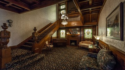 Grand foyer and staircase at Webb Noonan Kidd Funeral Home