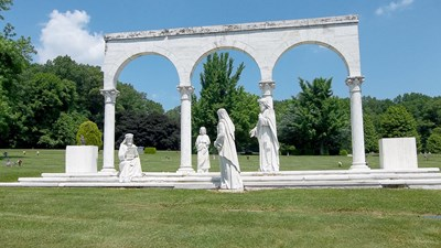 Close up view of religious sculptures under arches at Susquehanna Memorial Gardens