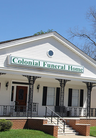 Front exterior building with signage at Colonial Funeral Home