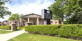 Front exterior building and signage at Coutts Funeral Home & Cremation Centre