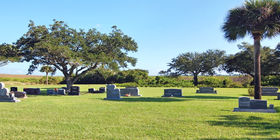 Cemetery grounds with above the ground headstones  at Aycock Funeral Home.