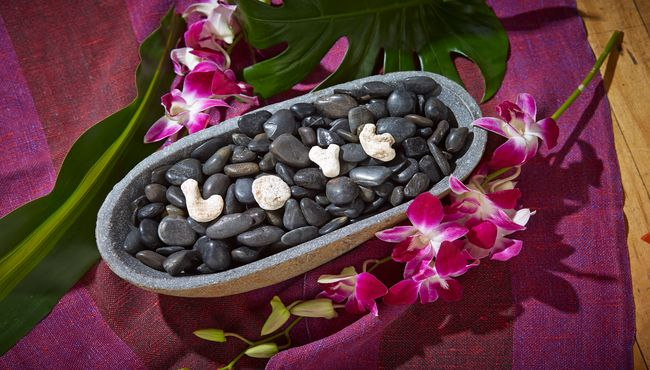 Tranquil black rocks in a bowl with love spelled out on top in white rocks.