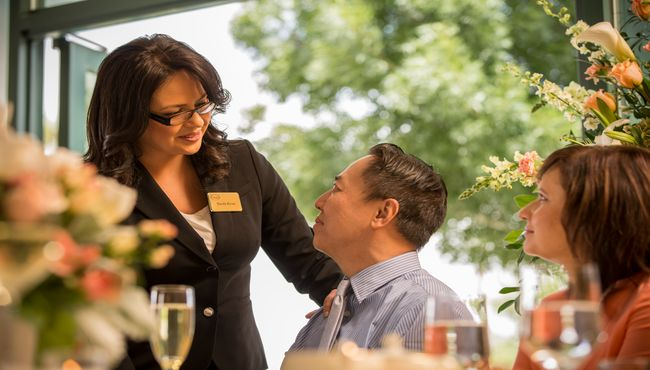 An associate provides professional and attentive service during a personalized Celebration of Life.