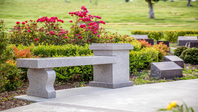 A cremation memorial designed as a bench allows a place for visitors to rest and reflect at Pacific View Memorial Park.