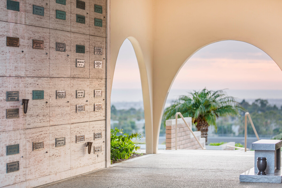 Inside a community mausoleum with rounded archways at Pacific View Memorial Park.