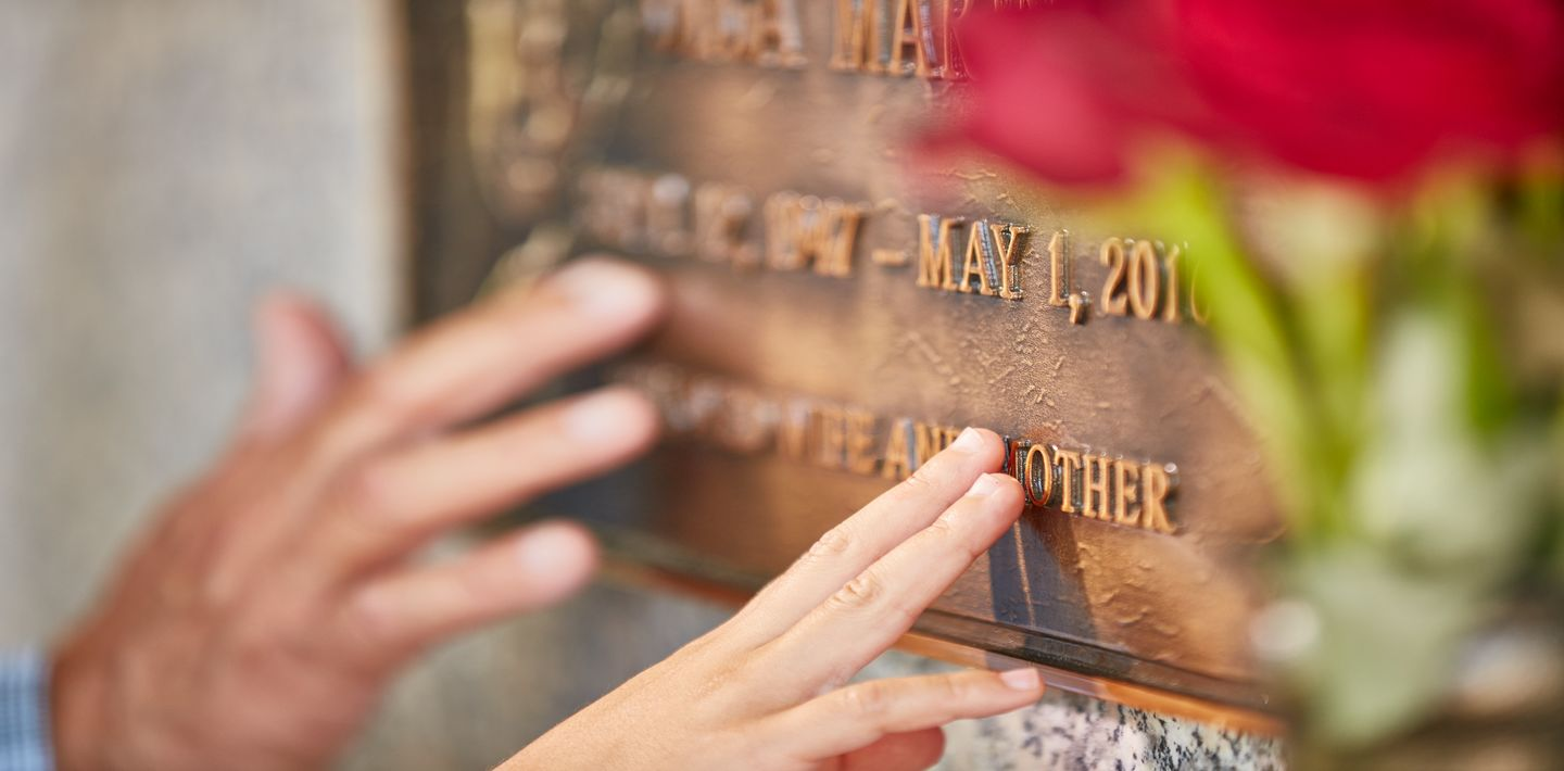 A bronze marker commemorates the life of a loved one and serves as a place to gather and remember for generations to come.