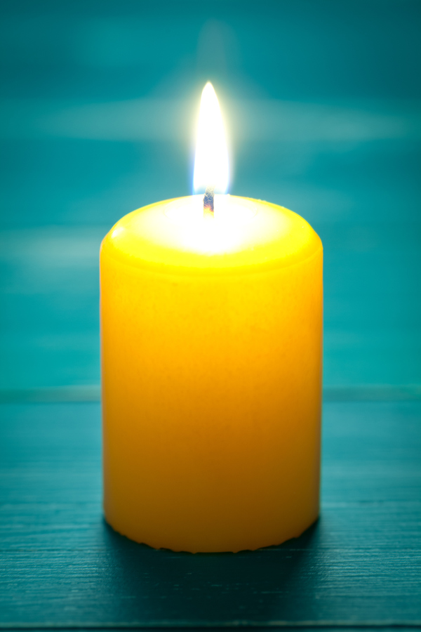 A single pillar candle that represents of the Jewish tradition of yahrzeit