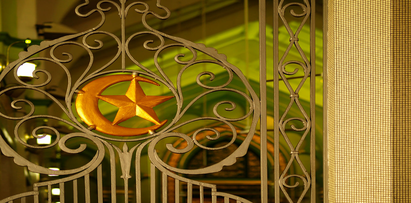 A gate with the star and crescent of Islam.