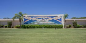 Mausoleum exterior with rainbow and doves mural at Sunland Memorial Park & Mortuary.