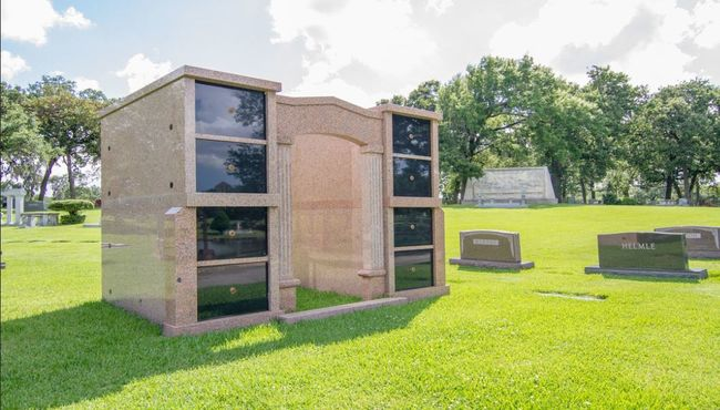 Granite private family mausoleum holding eight crypts.
