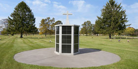 Columbarium with cross statue on top at Miami Valley Memorial Gardens.