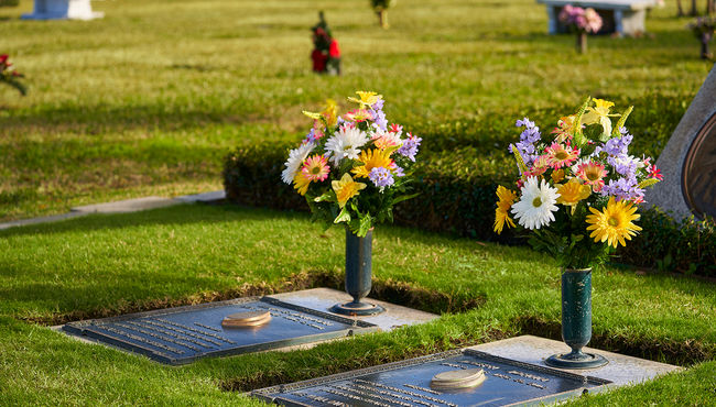 Beautiful arrangement hand-placed by Cemetery Flowers