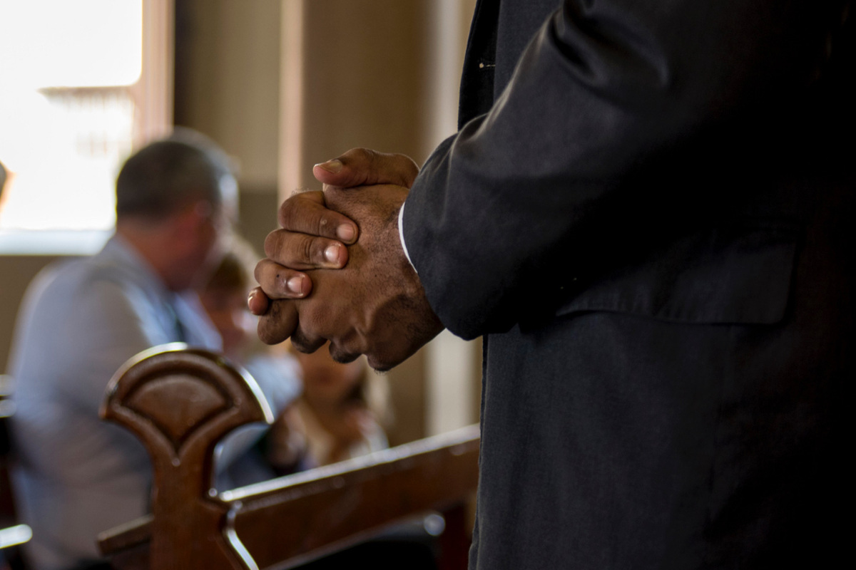 hands clasped in church