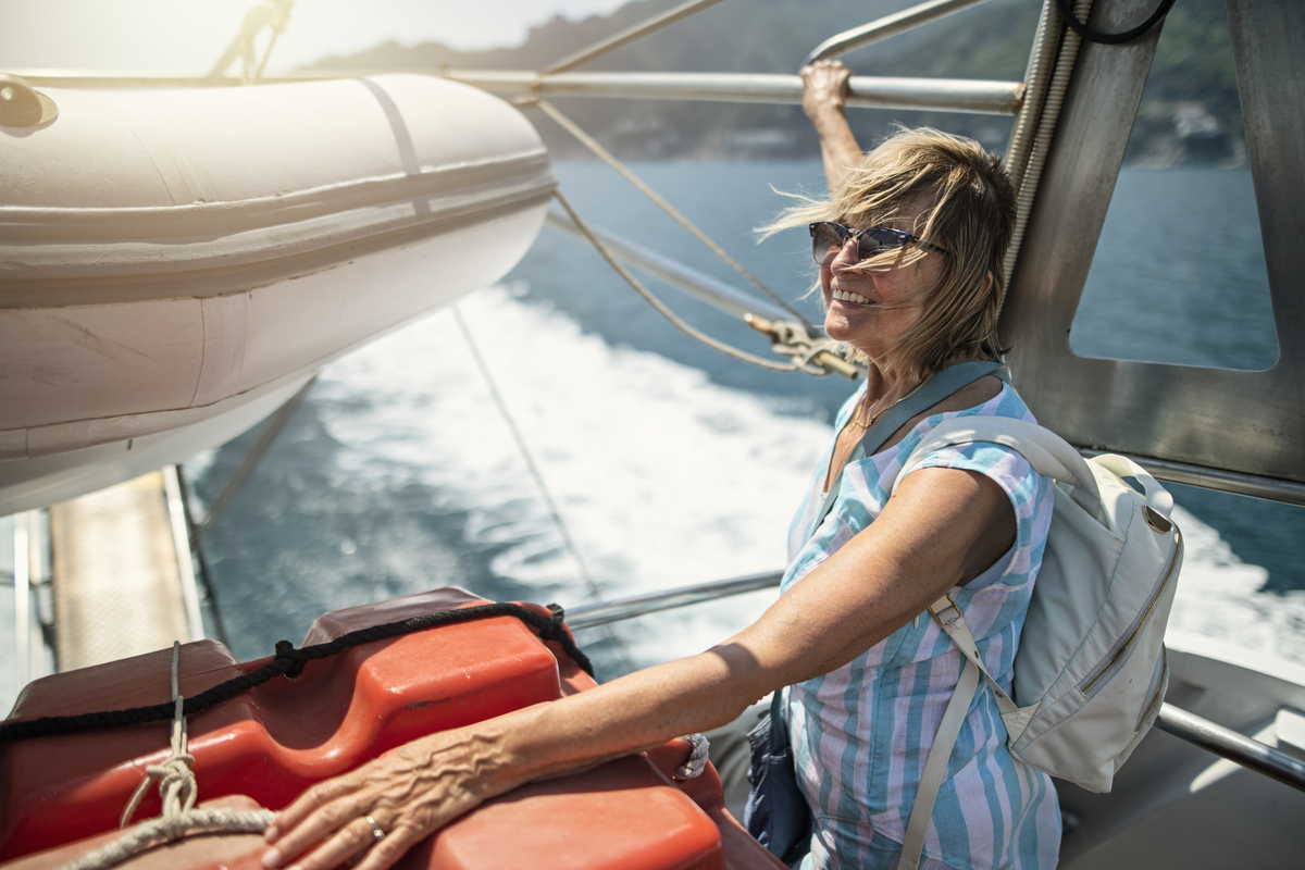 senior woman on boat travelling alone
